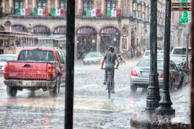person riding a bicycle during rainy day