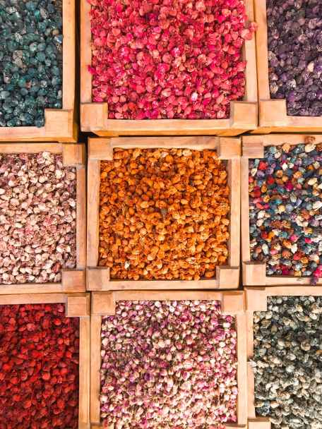 top view of assorted colored stones in wooden containers